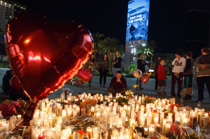 candles and flowers for las vegas shooting victims